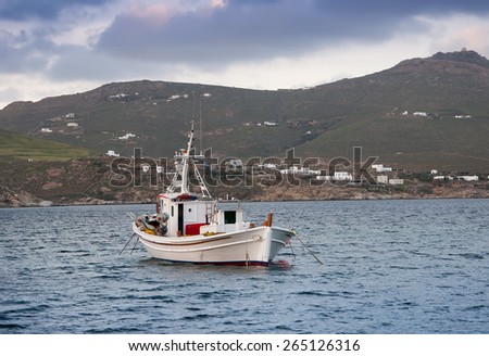 Classic fishing boat in the sea. Greece. Mykonos. - stock photo
