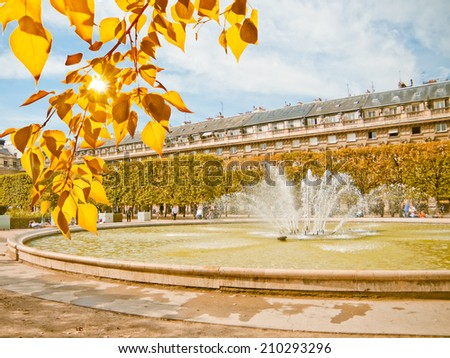Classic fountain in paris royal park with water reflection  - stock photo