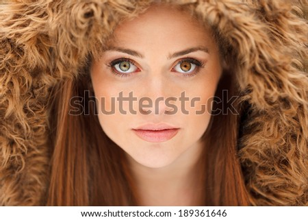 Classic glamor portrait of young woman. Straight looking at the camera showing outstanding eyes -?? eyes with heterochromia. - stock photo