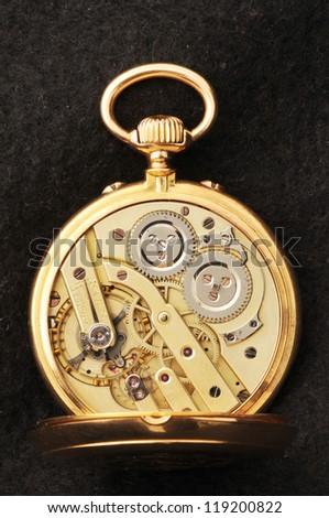 classic gold pocket watch - stock photo