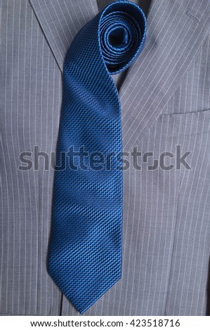 Classic gray striped business suit and blue tie. Fashion and classic trends - stock photo