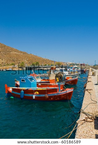 Classic Greek Fishing boats in the port berth. - stock photo