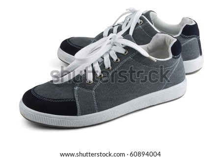 Classic grey sneakers isolated on white - stock photo