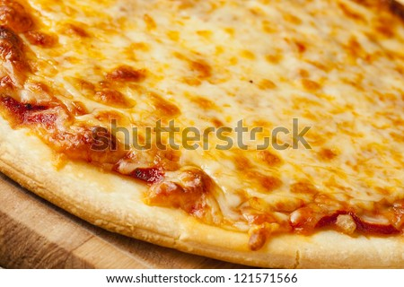 Classic Homemade Italian Cheese Pizza fresh out of the oven - stock photo