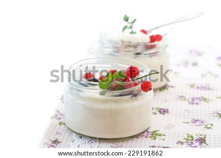 classic homemade yogurt in a glass jar with berries - stock photo