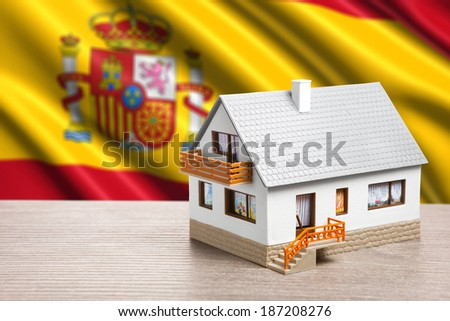 classic house against Spanish flag background - stock photo