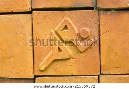 Classic icon of the running. Running sign on earthenware brick  - stock photo