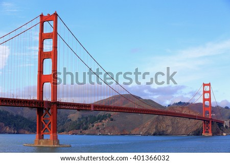 Classic image of the Golden Gate Bridge, California's landmark structure, under sunny skies. - stock photo