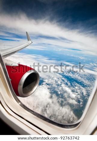 Classic image through aircraft window onto jet engine - stock photo