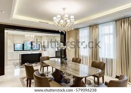 Classic Interior Of Dining Room In Brown White Beige Colors With Crystal Chandelier