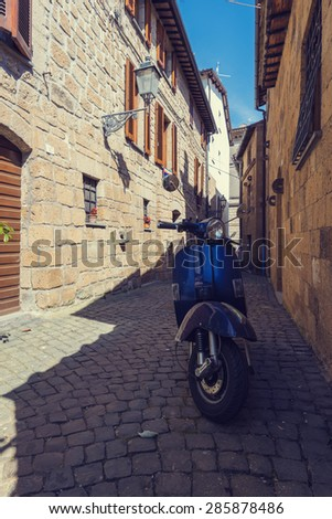 Classic Italian mode of transport through the narrow winding streets - stock photo