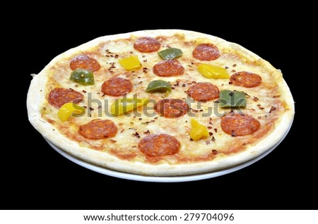 Classic italian pizza with mozzarella chees, oregano, pepperoni and grilled peppers isolated in white plate on black background. Point of view - stock photo