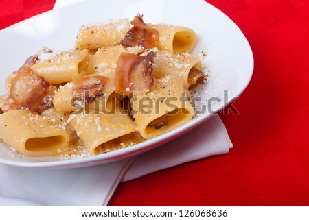 Classic italian recipe Carbonara made with paccheri - stock photo
