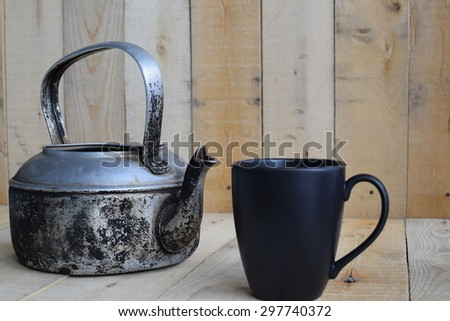 Classic kettle with black white cup on wood board