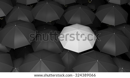 Classic large black umbrellas tops with one white standing out. - stock photo