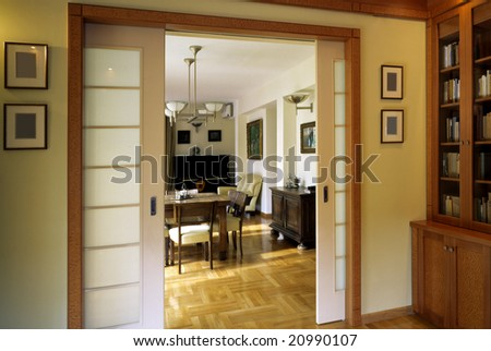 classic library with dining room - stock photo