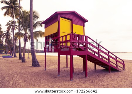 Classic lifeguard station on empty tropical beach on cloudy day in low season - stock photo
