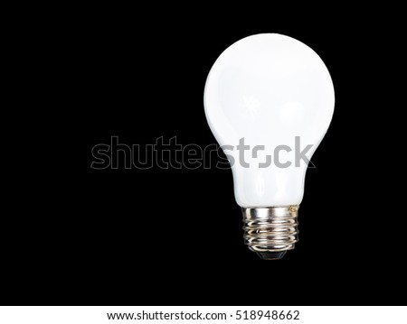 Classic light bulb isolated on black background