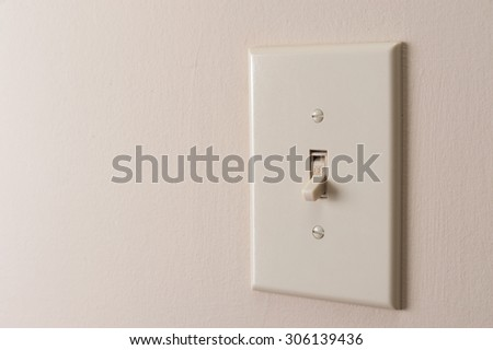 Classic light switch hanging on the wall - stock photo