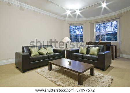 classic living room with oval bay window and dining area - stock photo