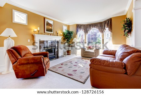 Classic luxury cozy living room interior with fireplace and leather. - stock photo