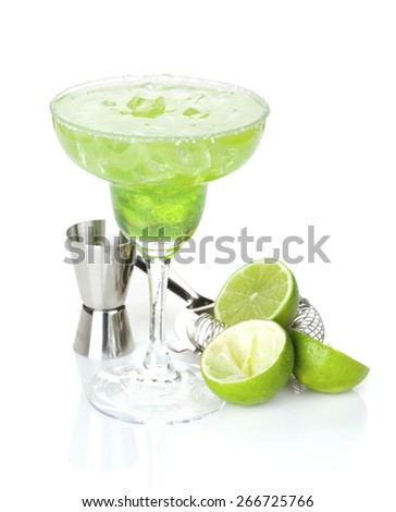 Classic margarita cocktail with salty rim with limes and drink utensils. Isolated on white background - stock photo
