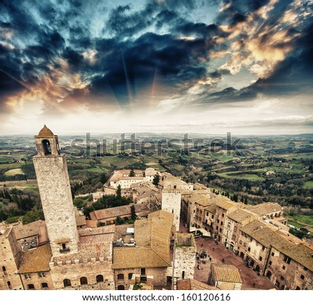 Classic medieval town of San Gimignano, Italy. Beautiful skyline at sunset. - stock photo