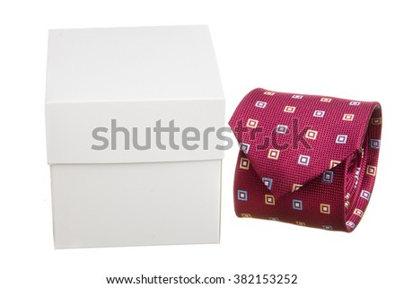Classic men's necktie rolled with package box - stock photo