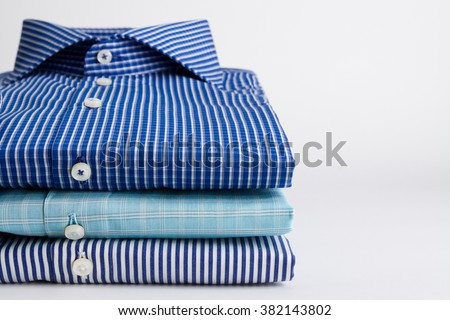 Classic men's shirts stacked - stock photo