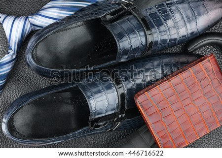 Classic mens blue shoes, tie, umbrella, purse on natural leather, can be used as background - stock photo