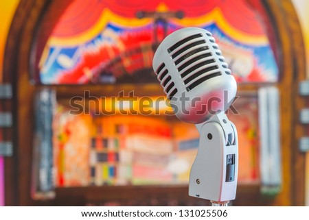 Classic microphone on colorful blur background - stock photo