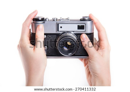 Classic 35mm old analog camera on white  - stock photo