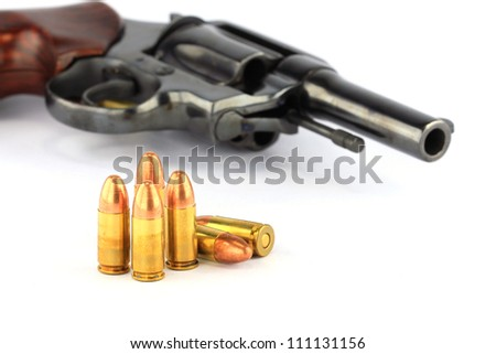 Classic .38mm revolver handgun with bullets on white background - stock photo