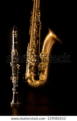 Classic music Sax tenor saxophone and clarinet in black background - stock photo