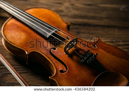 Classic music violin vintage in wooden background, close-up. - stock photo