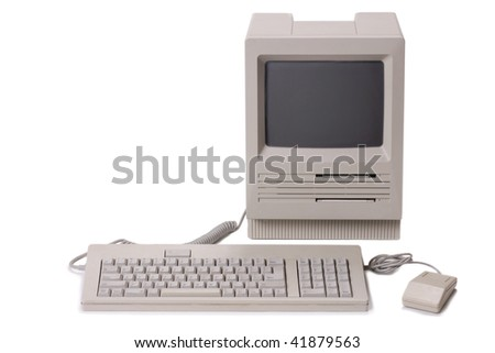 Classic nineteen eighties Apple Mac SE desktop personal computer with mouse and keyboard on a white background - stock photo