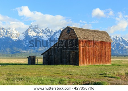Classic old barn with the Grand Teton, Wyoming, USA. - stock photo