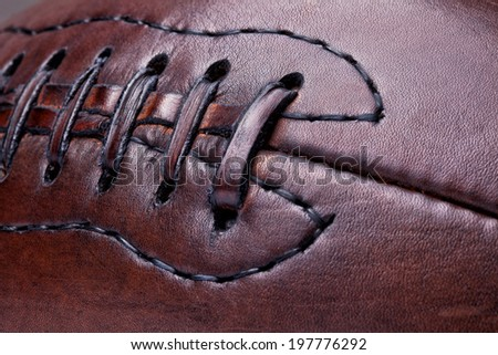 classic old leather football background - stock photo