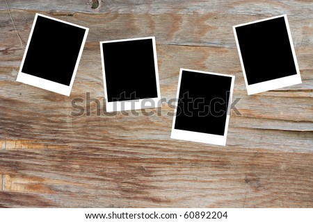 classic old photo Held By Clothespins with grunge background