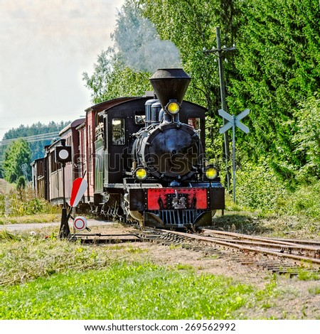 Classic old steam train arrives to station. Minkio, Finland - stock photo