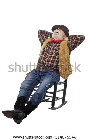 Classic Old West style laughing cowboy with felt hat, grey whiskers, revolver. He relaxes leaning back in a rocking chair. Isolated on white, vertical, copy space. - stock photo