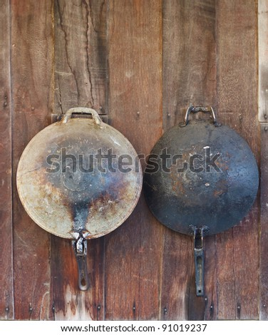 Classic pan on wooden backgrounds. - stock photo
