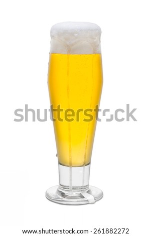 Classic Pilsner Beer with Foam Head and Drips Running Over Rim #5 - stock photo