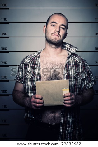 classic police photo of arrested criminal - stock photo