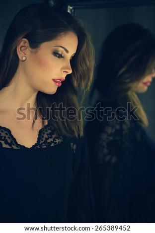 classic portrait of an attractive brunette woman - stock photo