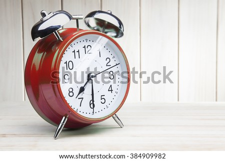 classic red alarm clock morning wake-up time - stock photo