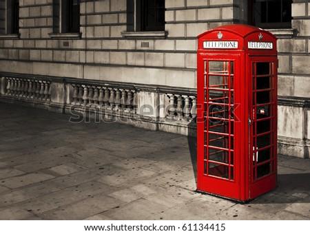 Classic red British telephone box in London - stock photo