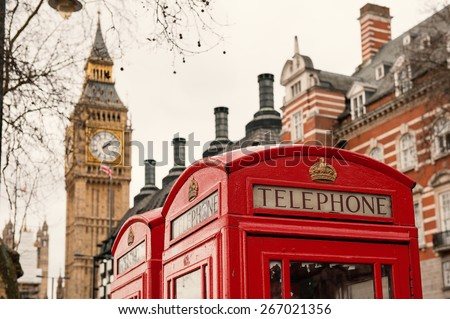 Classic red British telephone boxes with Big Bang in the background. - stock photo