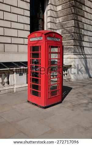 Classic red telephone booth in London - stock photo