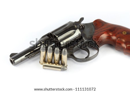 Classic .38 revolver handgun with bullets on white background